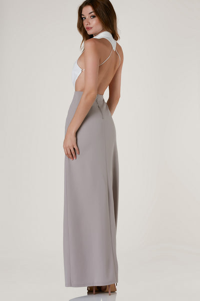 Stunning sleeveless maxi dress with chic mock neckline and off center slit in front. Cut out back with strappy detailing and color block design.