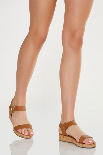Basic two strap sandals with chic cork sole and adjustable ankle strap finish.