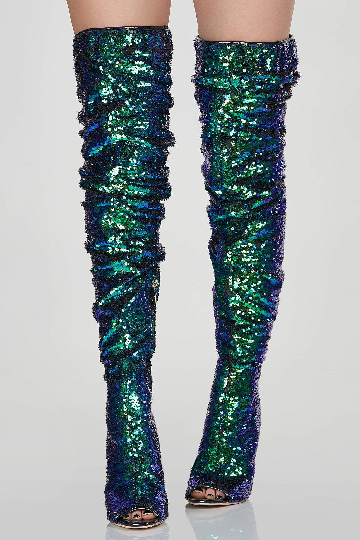 Sexy thigh high stilettos with gorgeous sequin finish. Side zip closure with scrunched finish.