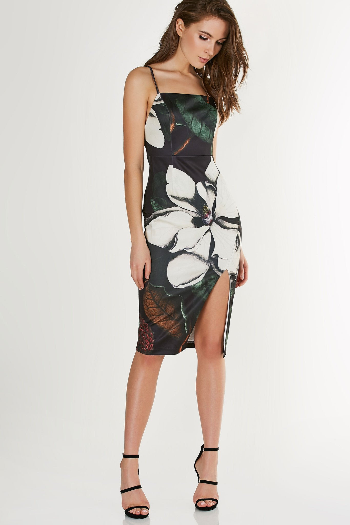 Printed sleeveless midi dress with boxi neckline and structured fit. Fully lined with floral patterns throughout. Asymmetrical slit in front with hidden back zip closure.