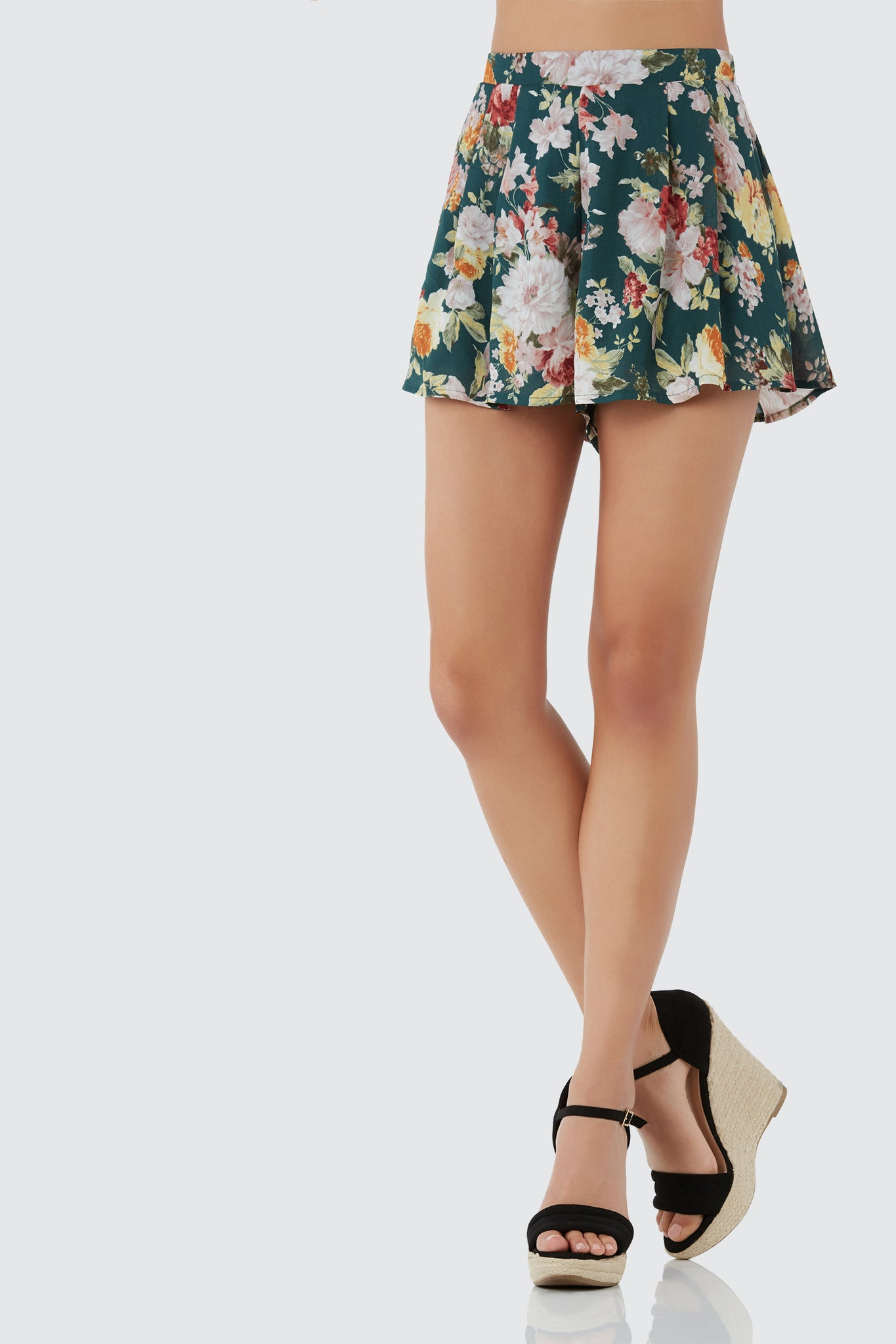 Fully lined chiffon shorts with floral print throughout. High rise waist with elasticized band for comfortable fit.
