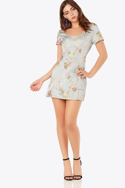 Elegant short sleeve dress with rounded neckline. Floral print throughout with back zip closure.