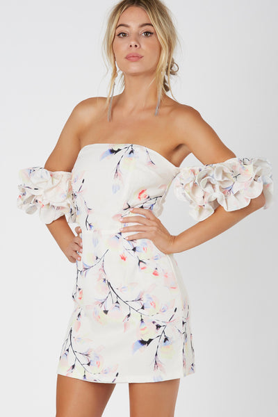 Flirty off shoulder dress with colorful floral patterns throughout. Fun ruffled sleeves for added detail and back zip closure.