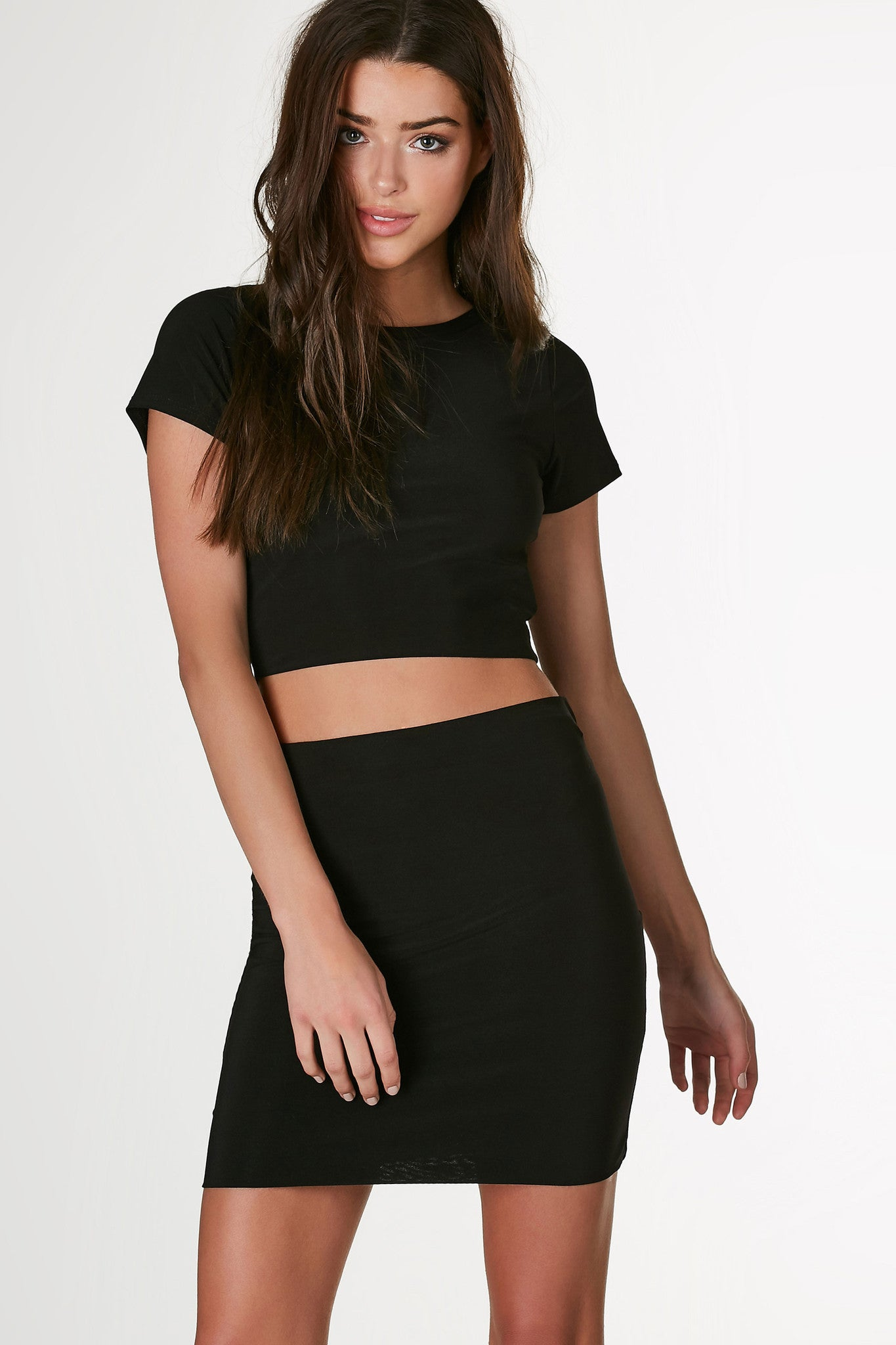 Classic crew neck short sleeve top with cropped hem and slim fit. Stretchy slinky material and double lined finish.