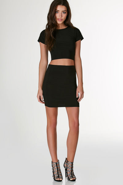 Double lined mid rise skirt with bodycon fit. Slinky material with straight hem all around.