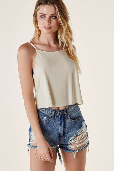 Basic spaghetti strap tank top with flowy fit. Cropped raw cut hem with lower back finish.
