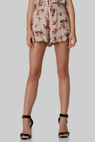 Fully lined classic waisted shorts with delicate floral patterns throughout. Adorable ruffle trimming all around.
