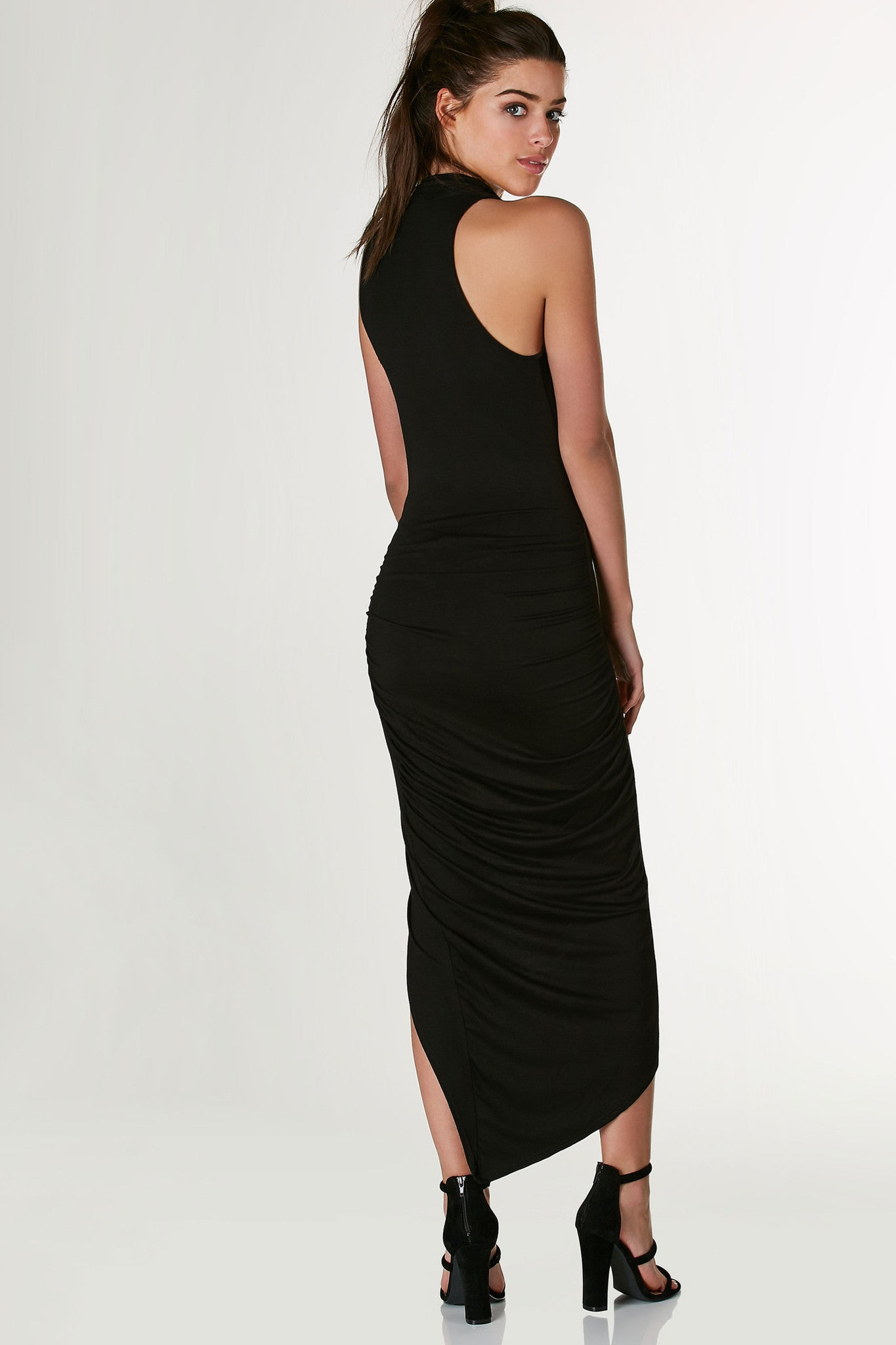 Sexy sleeveless dress with draped open neckline. Ruched on one side with hi-low enveloped, asymmetrical hem.