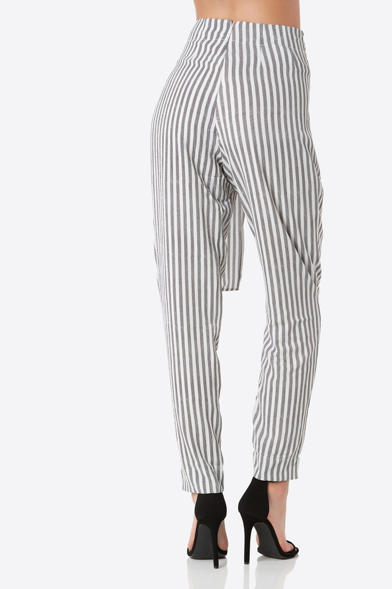 Chic high rise pants with stripe print throughout. Wrap front detailing with back zip closure.
