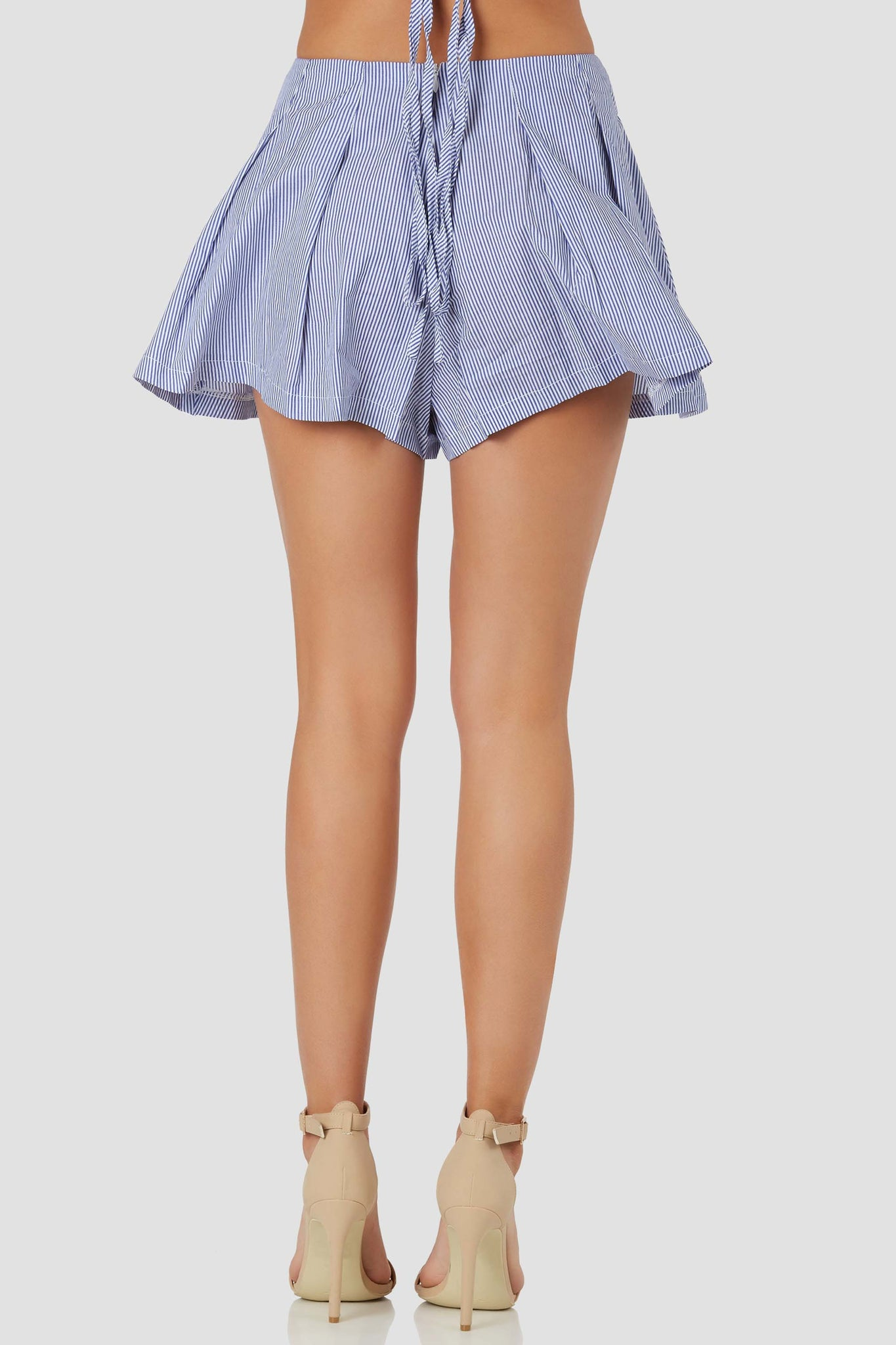 Flirty high rise shorts with trendy strie patterns throughout. Flared A-line hem with lace up detailing in front and back zip closure.