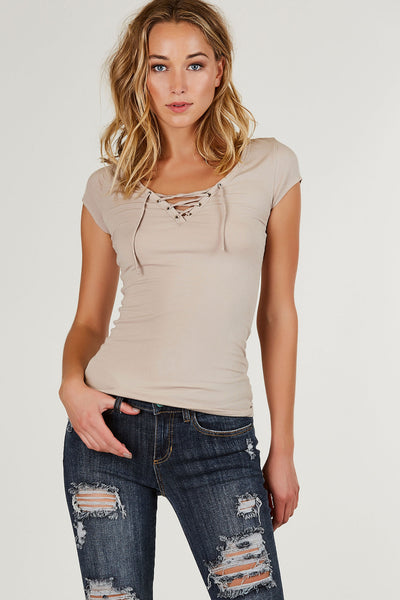 Basic ribbed short sleeve top with lace up V-neckline. Silver hardware eyelet detailing with longline fit.