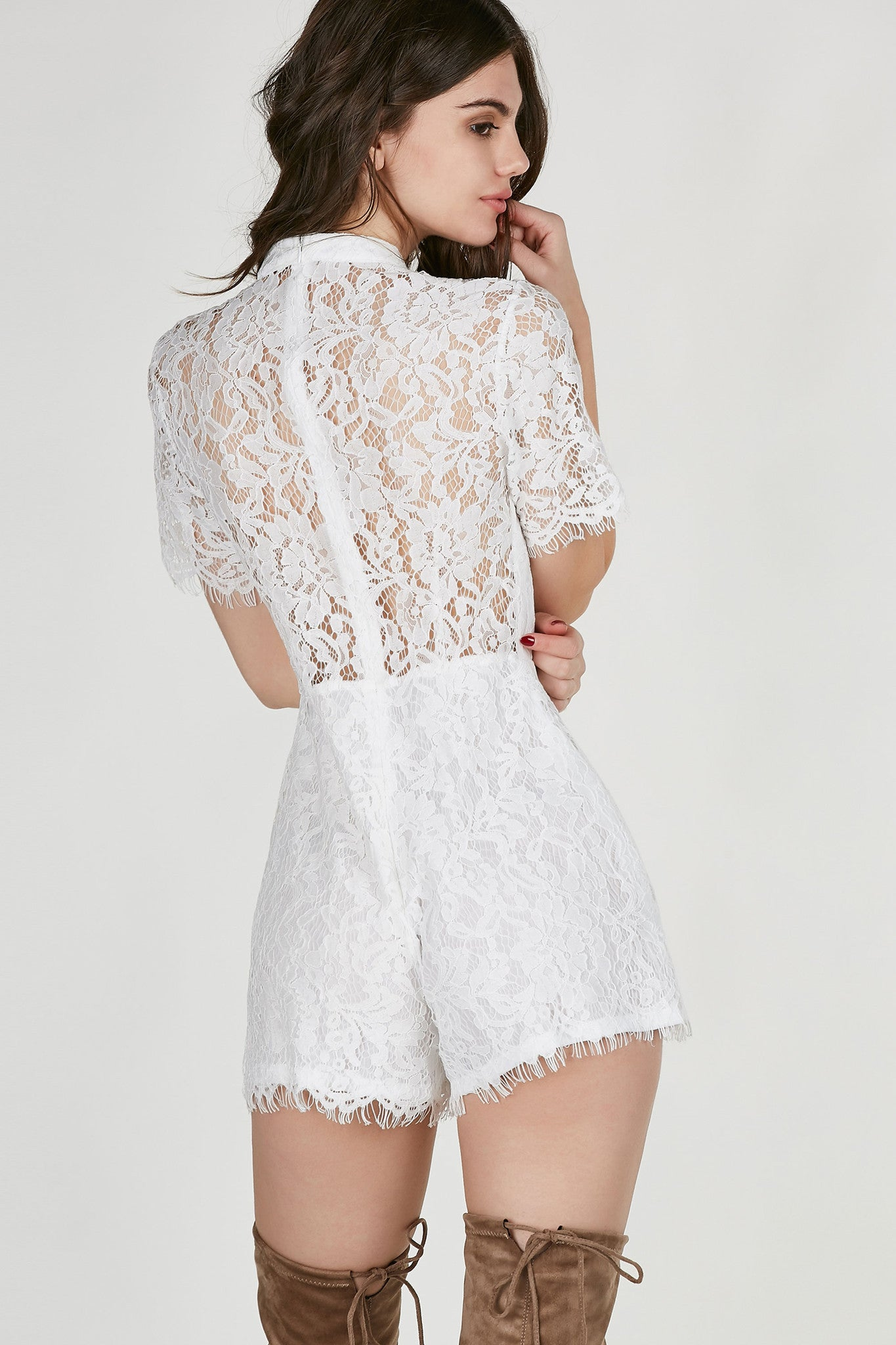 Mock neck short sleeve romper with delicate lace finish all around. Lined with hidden back zip closure.
