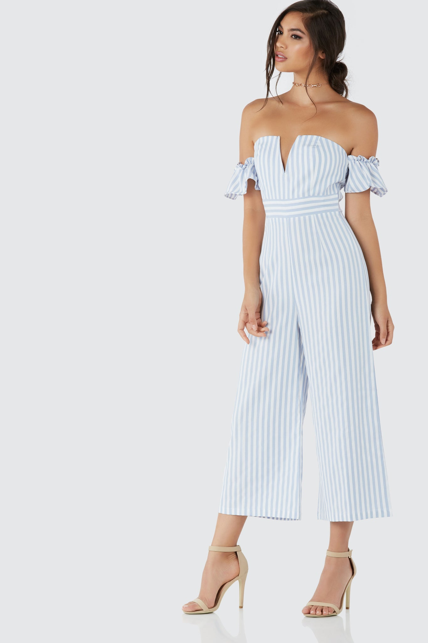 Chic off shoulder jumpsuit with wired V-cut at neckline. Stripe patterns throughout with cropped wide leg fit.