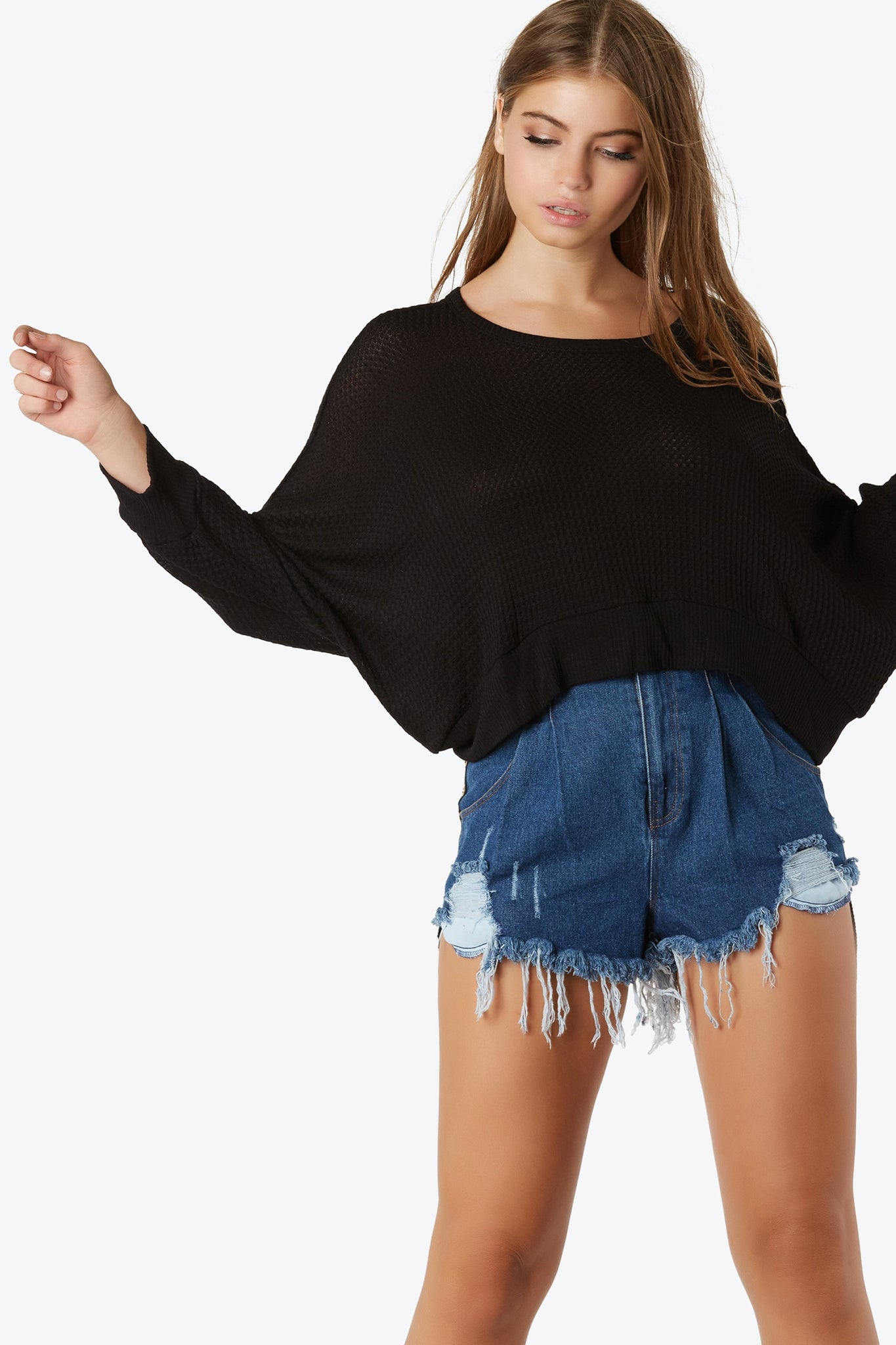 Super comfy waffle knit top with batwing sleeves. Oversized sleeves with rounded neckline and cut out back.