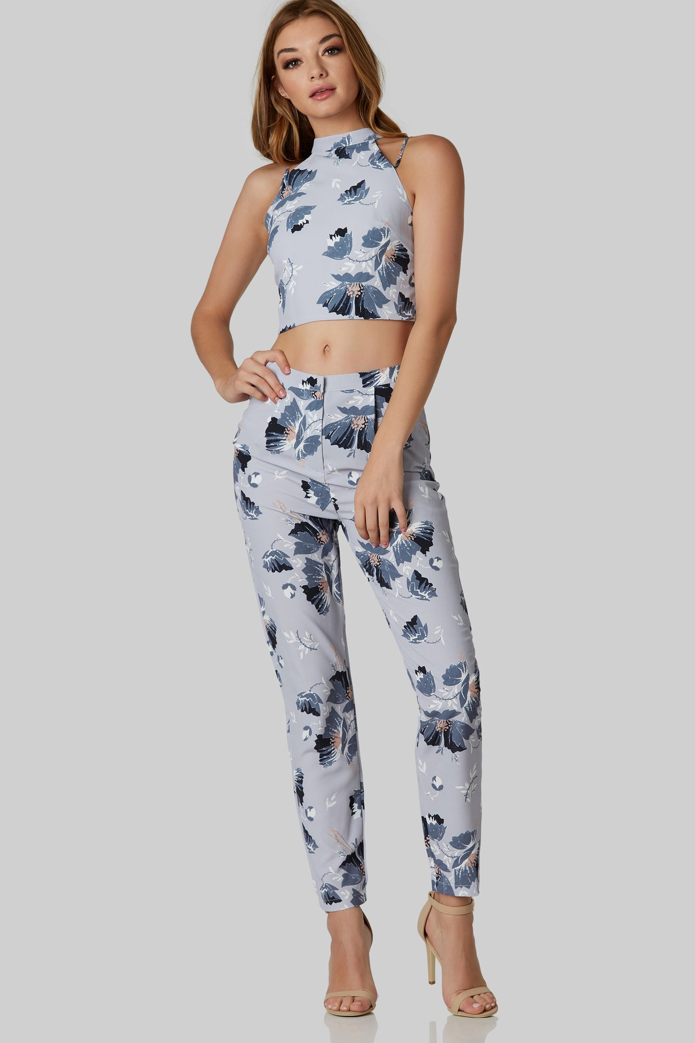 Chic high rise slacks with floral print throughout. Back pockets with front zip and hook closure.