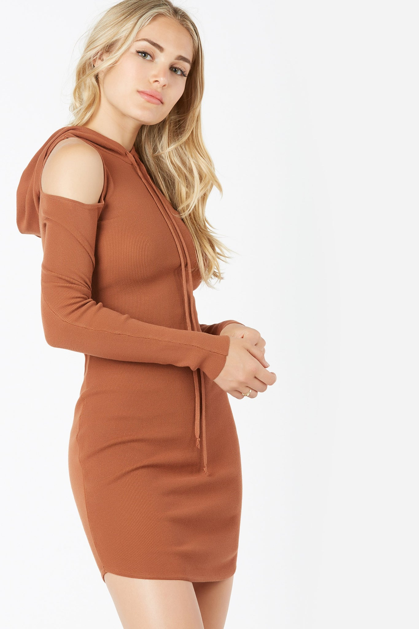 Casual long sleeve sweater dress with cold shoulder cut outs. Bodycon fit with attached hood and drawstring detail.