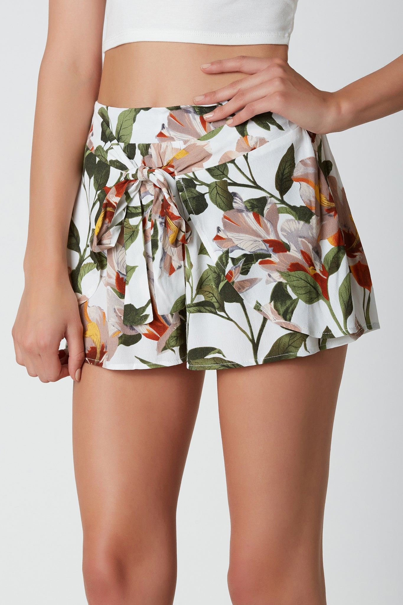 Flirty printed shorts with A-line hem and floral patterns throughout. Front tie design with comfortable elasticized waistband.