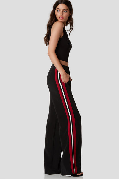 Trendy high rise pants with comfortable wide leg fit. Colorblock stripes down each side and side pockets for functionality.