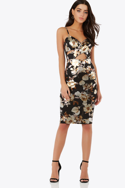 Take the night the with the thin printed midi dress. Features front cut outs, thin straps, and a hidden zipper closure.