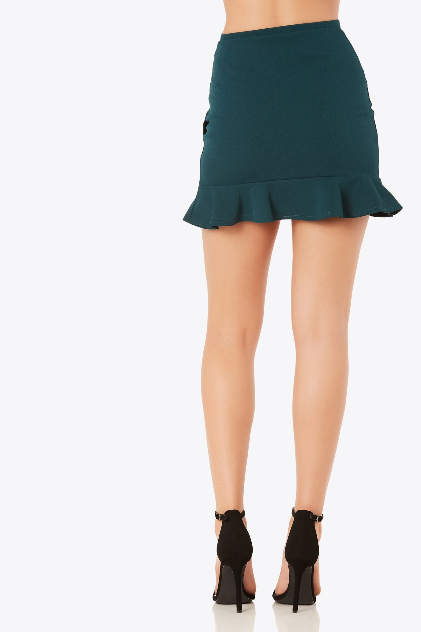 Flirty high rise mini skirt with tulip style design. Ruffle trim detailing with stretchy fit.