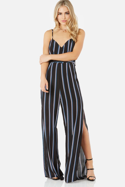 Chic V-neck jumpsuit with double shoulder straps and waist tie detailing. Stripe patternt throughout with bold leg slits.