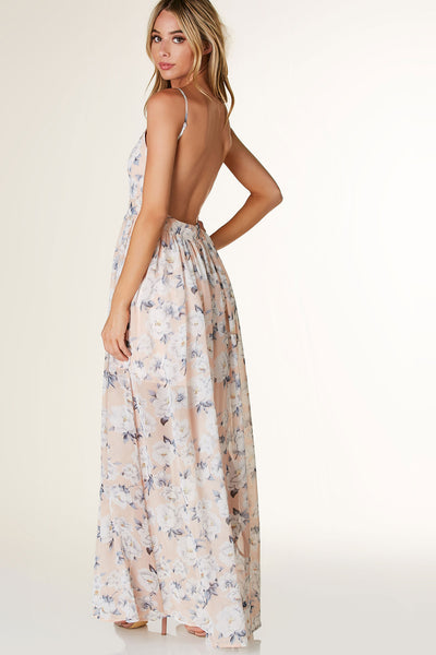 Gorgeous V-neck maxi dress with adjustable shoulder straps and open back. Fully lined with floral print throughout and hidden side zip closure.