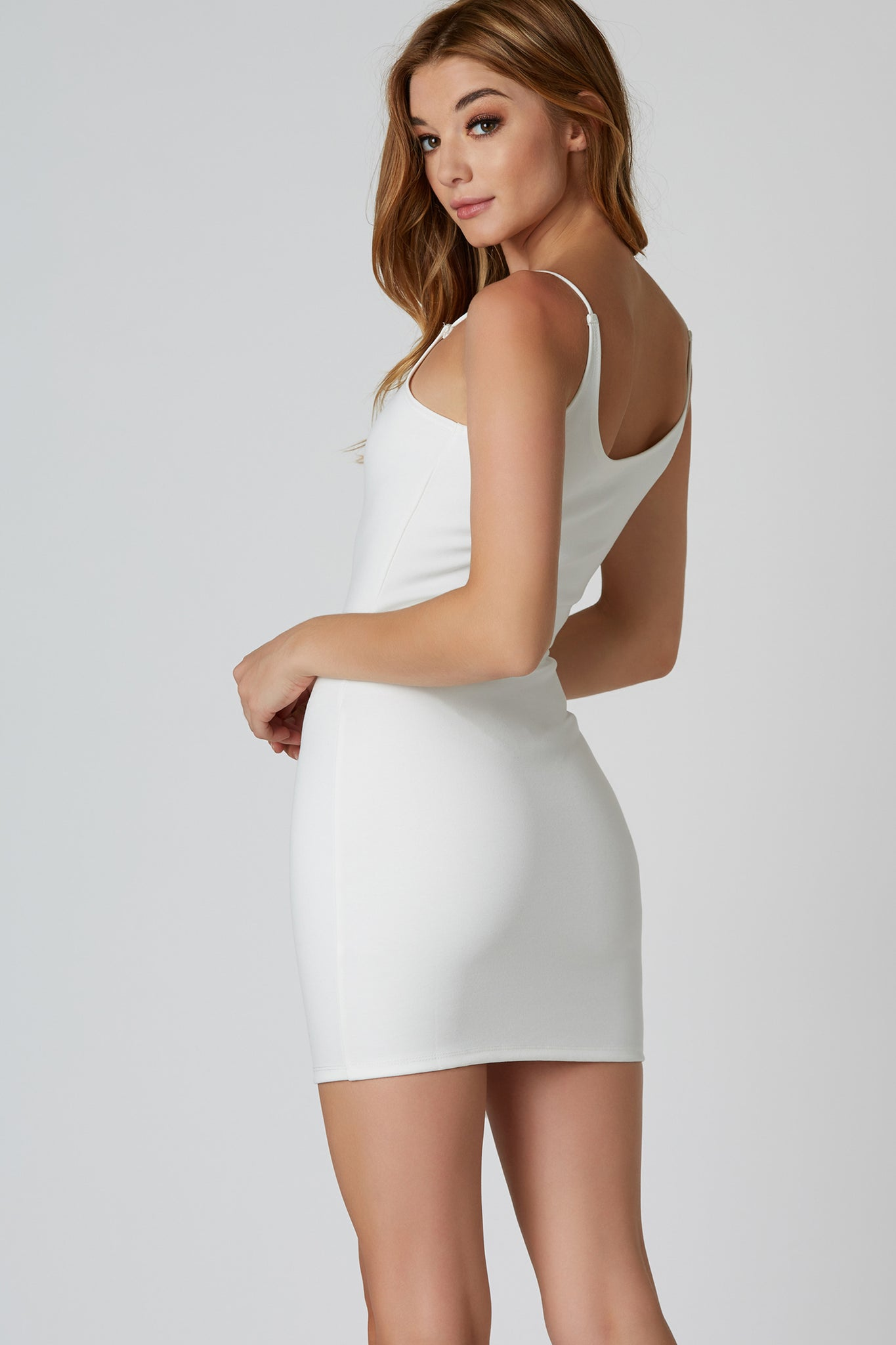 Sexy spaghetti strap mini dress with flattering bodycon fit. Stretchy material with rounded neckline and straight hem finish.