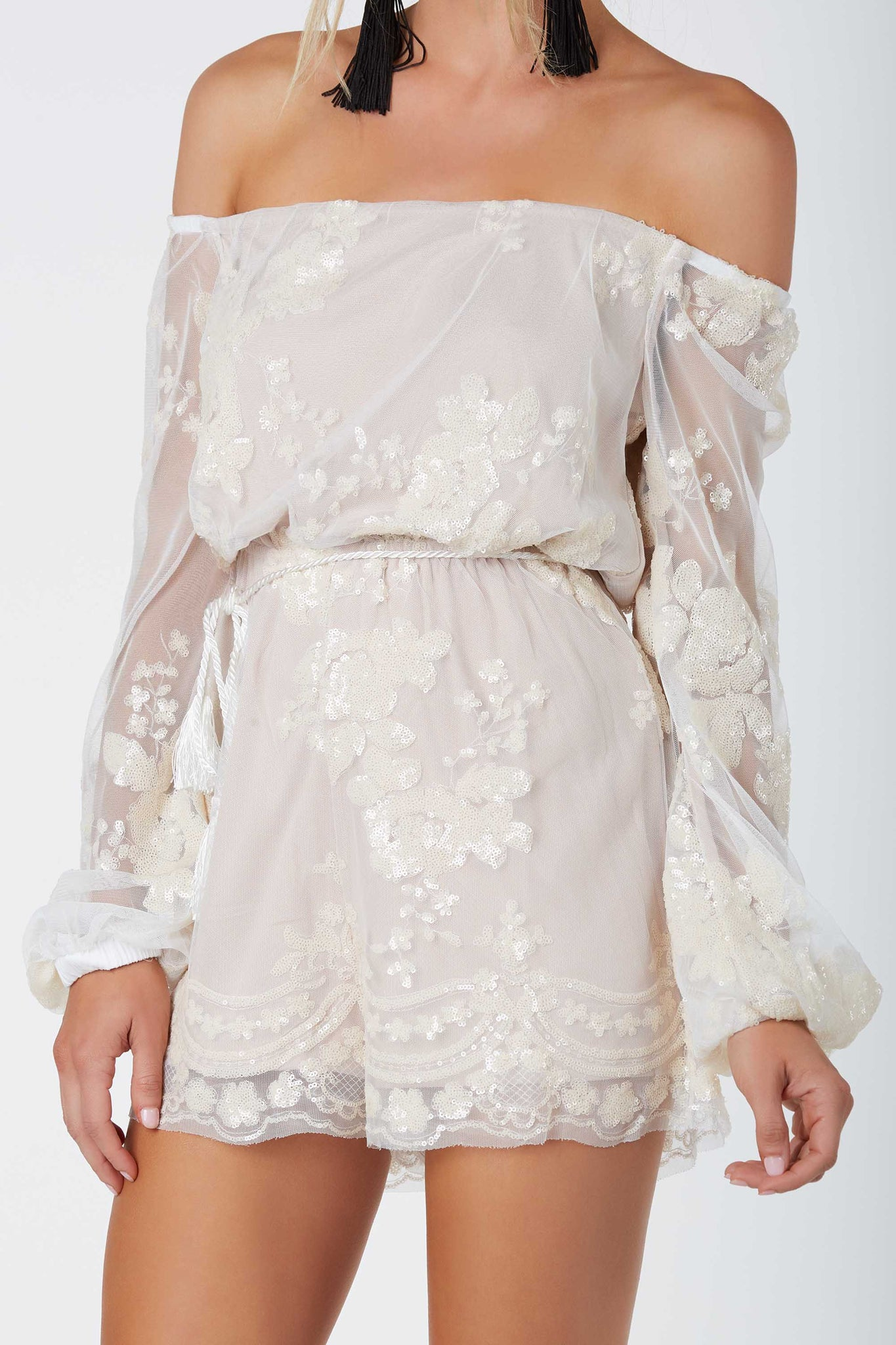 Stunning off shoulder mesh romper with chic nude lining and gorgeous sequin detailing throughout. Roped tie aroung the waist for added detail.