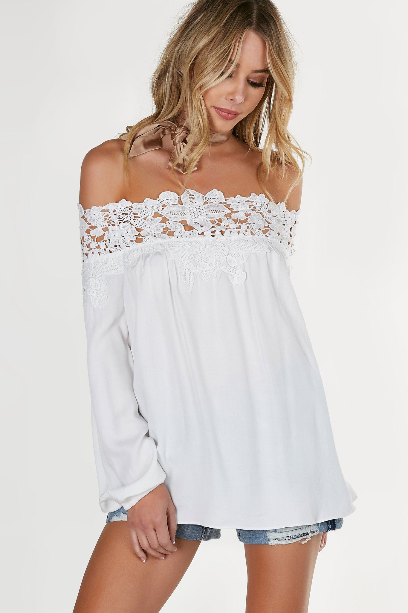 Flowy off shoulder top with intricate crochet detailing. Full length sleeves and longline hem.