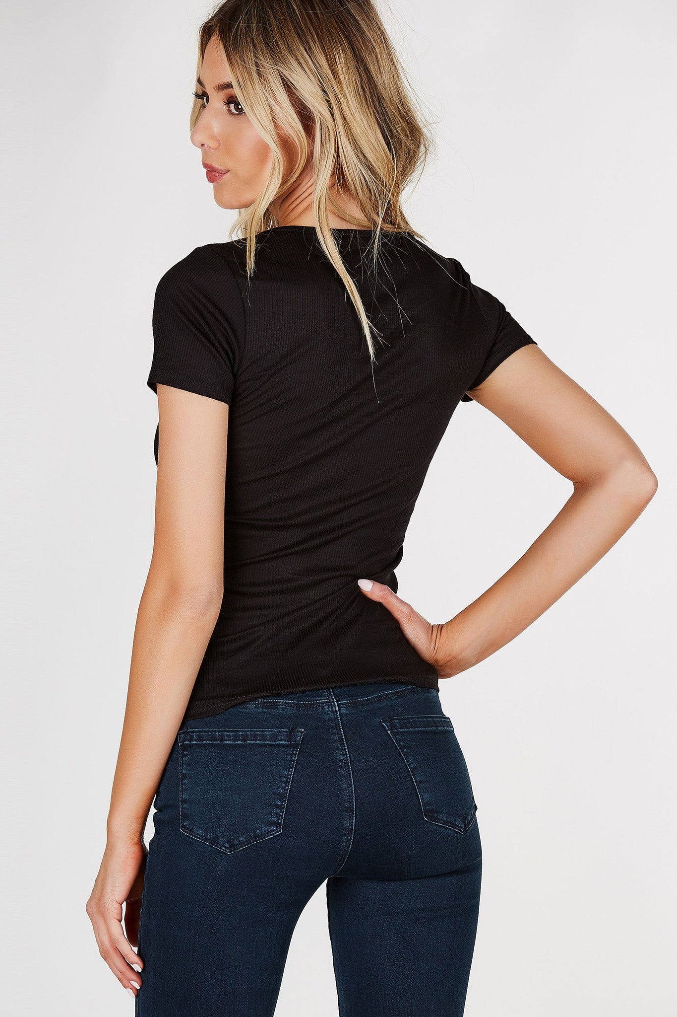 Deep V-neck short sleeve top with lace up detailing in front. Ribbed throughout with straight hem all around.