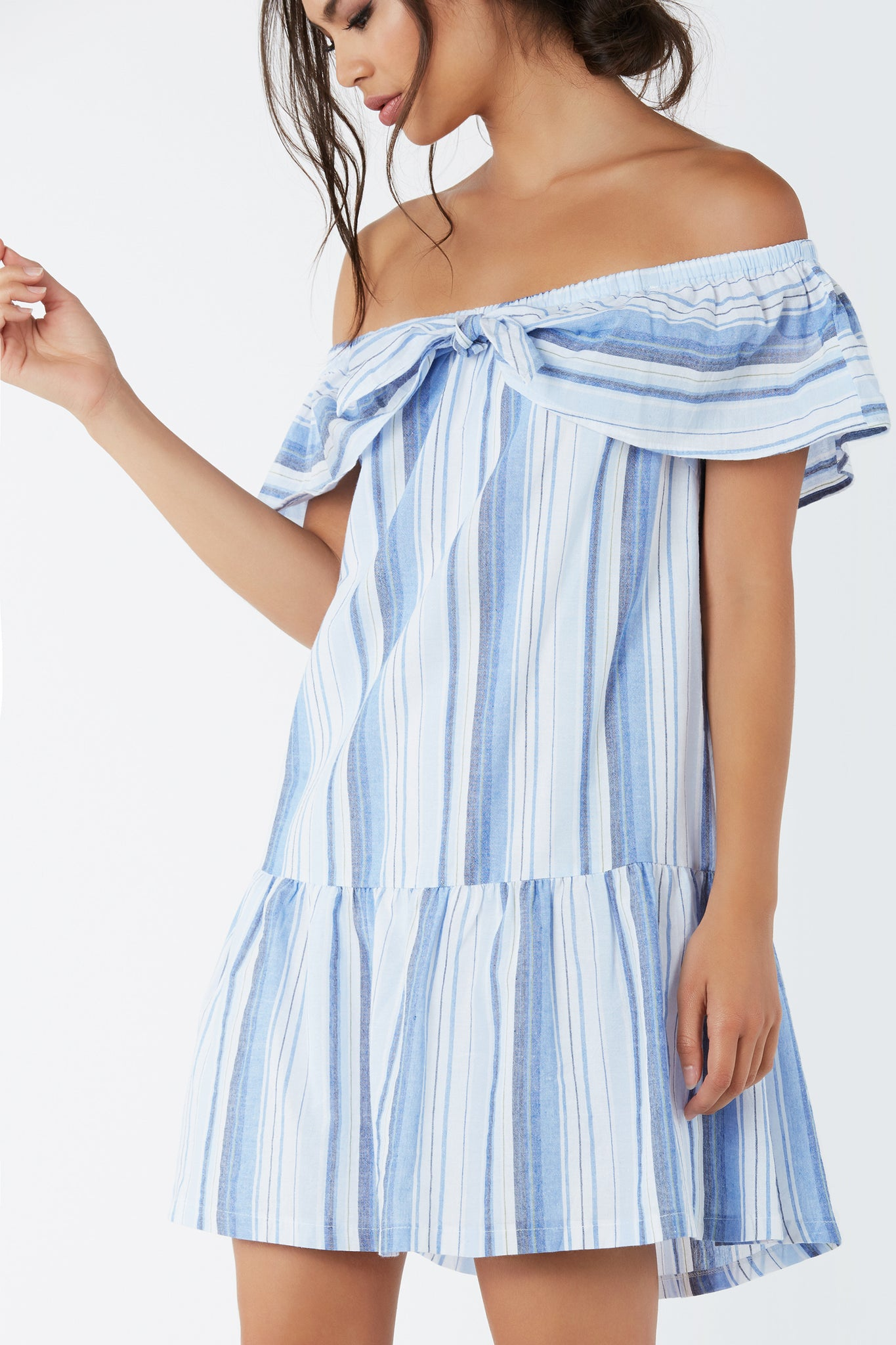 Flirty off shoulder dress with ruffle tier design that ties at center. Fully lined with stripe print throughout.
