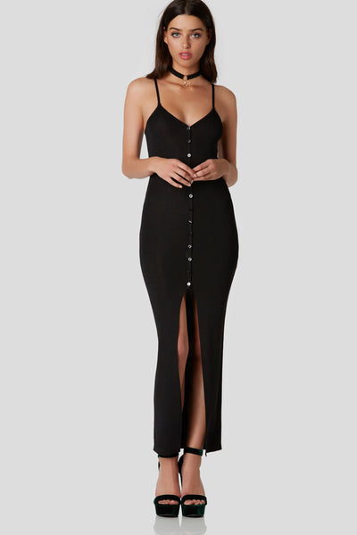 Slim fit midi dress with adjustable shoulder straps and button front closure. Bold center slit in front with straight hem finish.