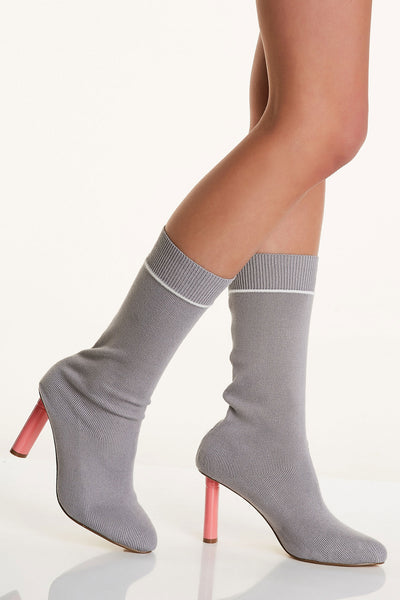 Bold designer inspired sock boots with contrast heels. Poinrted toe finish with athleisure style stripe pattern at top.
