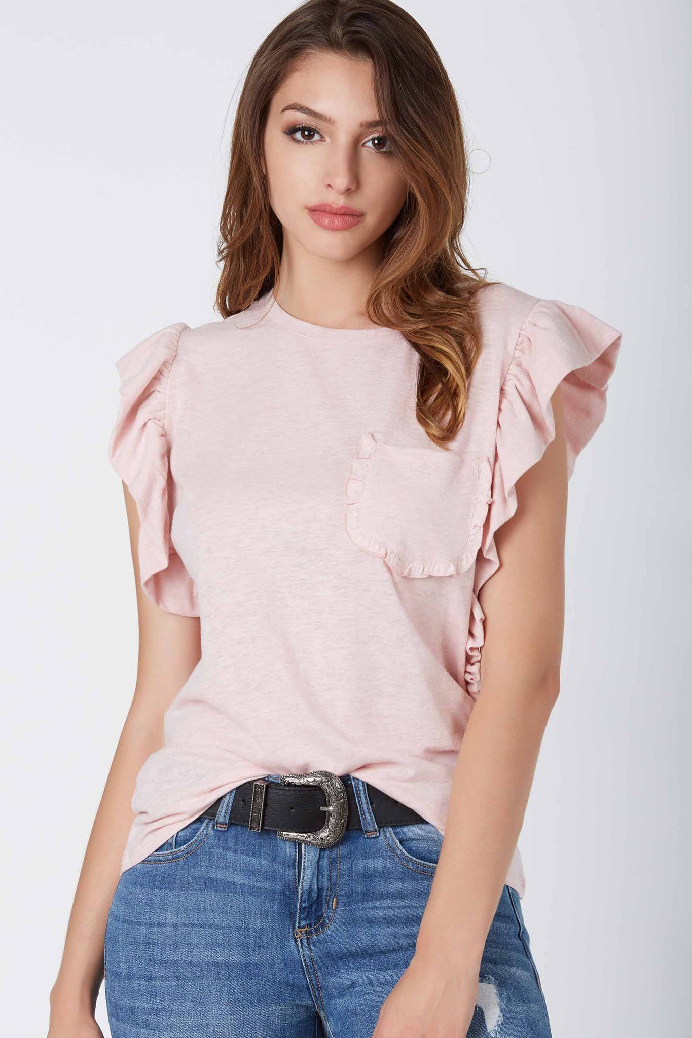 Crew neck cap sleeve top with flirty ruffle detailing and front pocket design. Relaxed fit with straight hem finish.