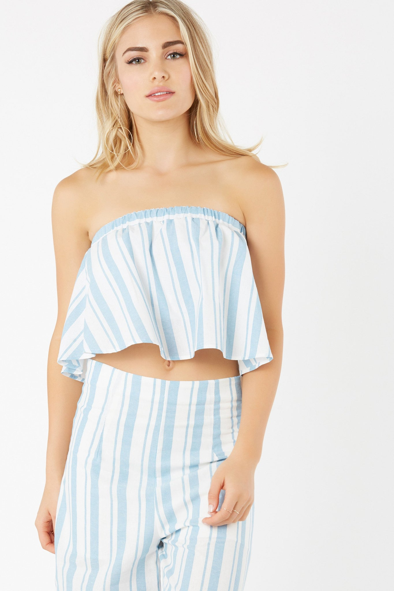 Sleeveless tube top with stripe pattern throughout. Smooth lining with elasticized band for fit.