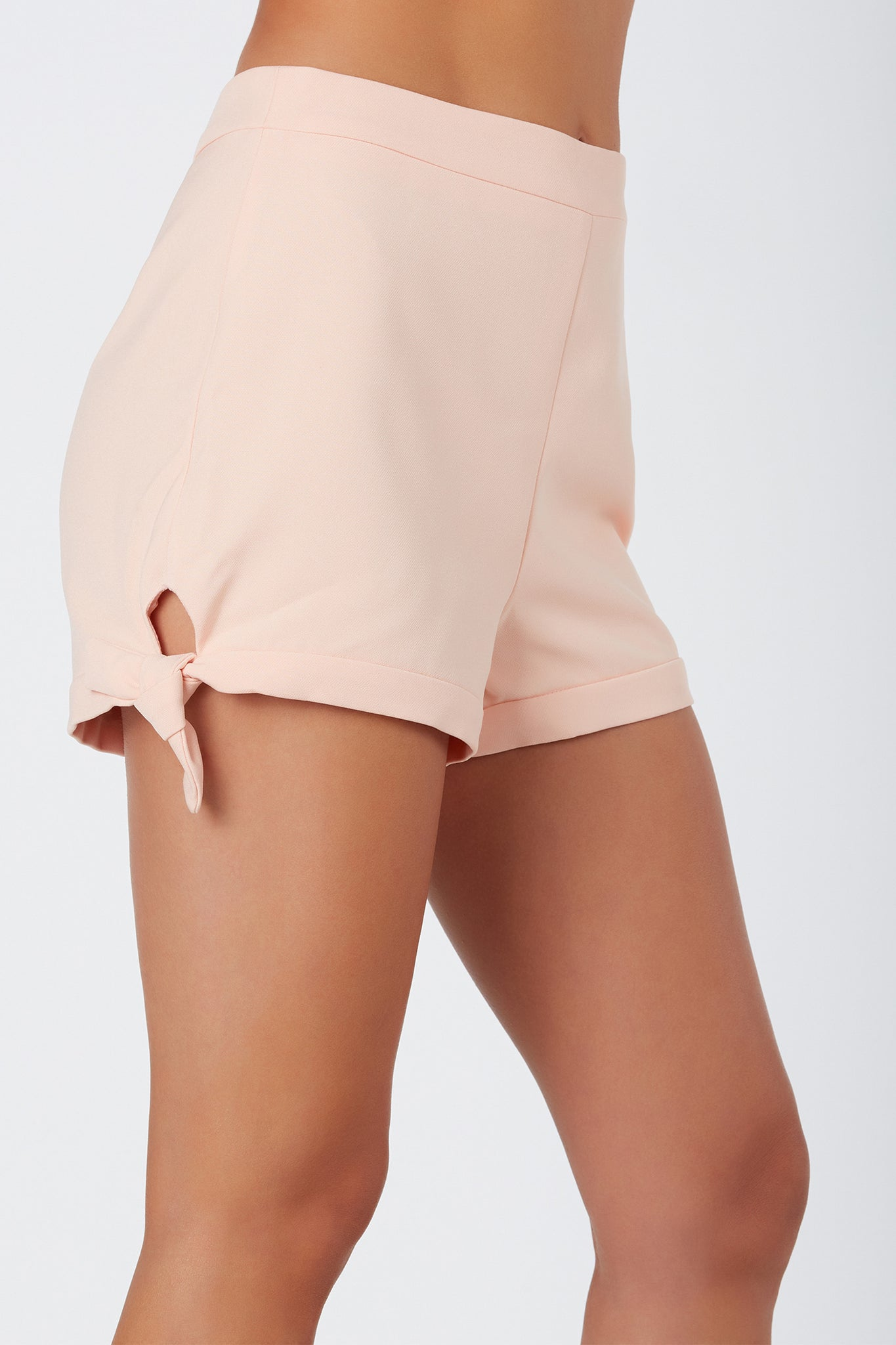 Solid high rise shorts with smooth lining for added comfort. Back zip closure and knot detailing at hem.