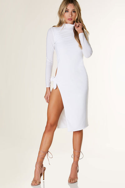 Sexy long sleeve mock neck midi dress with bold side slit with ties for closure. Flattering fit with straight hem all around.