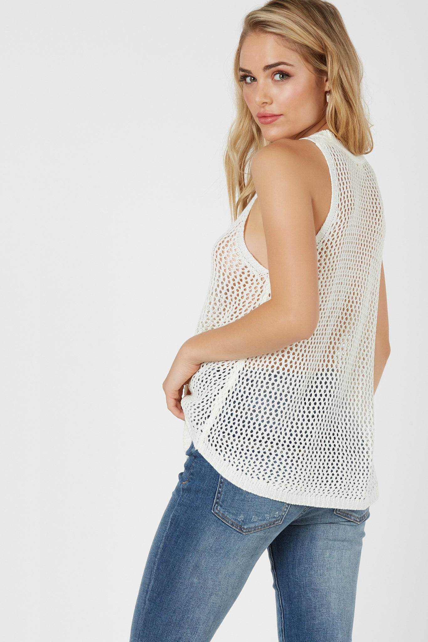 Casual sleeveless loose-knit top with V-shape cut out and lace up design. Relaxed fit with straight hem finish.