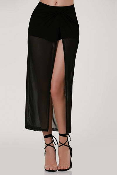 Sexy high rise maxi skirt with stretchy shorts lined underneath. Sheer mesh overlay with knotted detailing at waist and open slit in front.