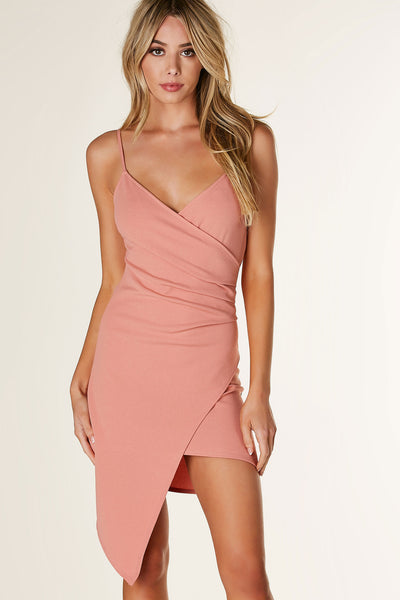 Flattering sleeveless asymmetrical dress with wrap design and slighty ruching on one side. Envelope style hem with stretchy form fitting material.