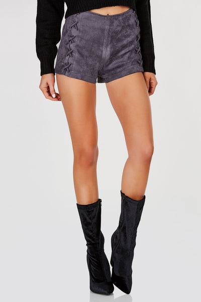 Mid rise suede shorts with lace up design. Stretchy fit with full lining and back zip closure.