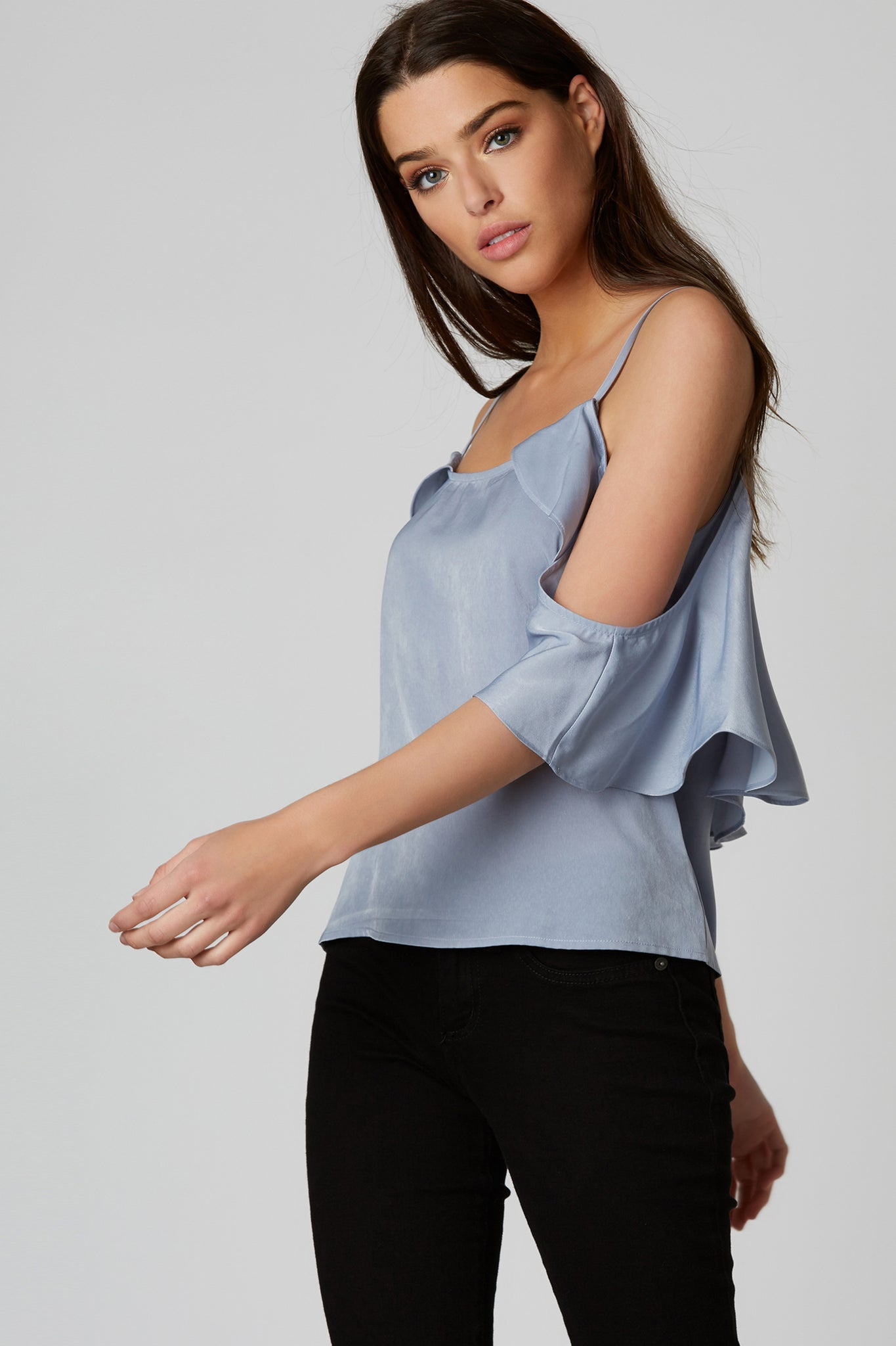 Adorable crop top with straight trim and ruffle sleeve detailing. Cold shoulder design with rounded neckline front and back.