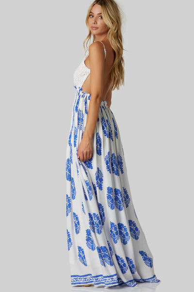 Stunning open back maxi dress with intricate crochet bust and adjustable shoulder straps. Fully lined with flowy hem and leaf patterns throughout.