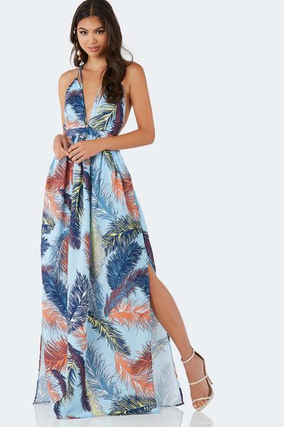Stunning spaghetti strap maxi dress with deep V-neckline. Colorful print throughout with open back and strappy finish.