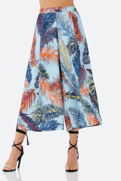 High rise cropped pants with tropical leaf print throughout. Wide leg fit with hidden side zip closure.