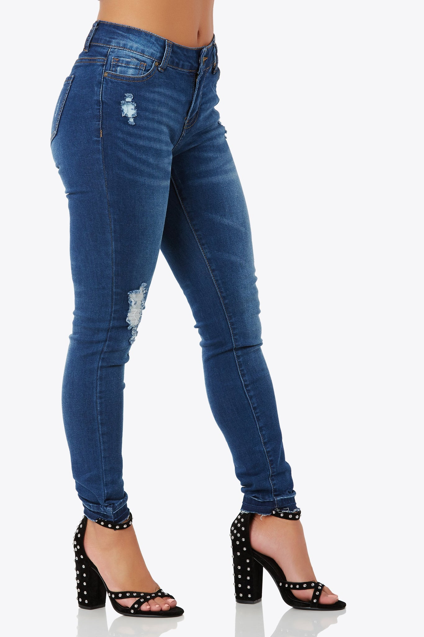 Add some edge to your style with these 5-pocket flexible denim jeans weith distressed accents througout. Front button fly and zipper closure.