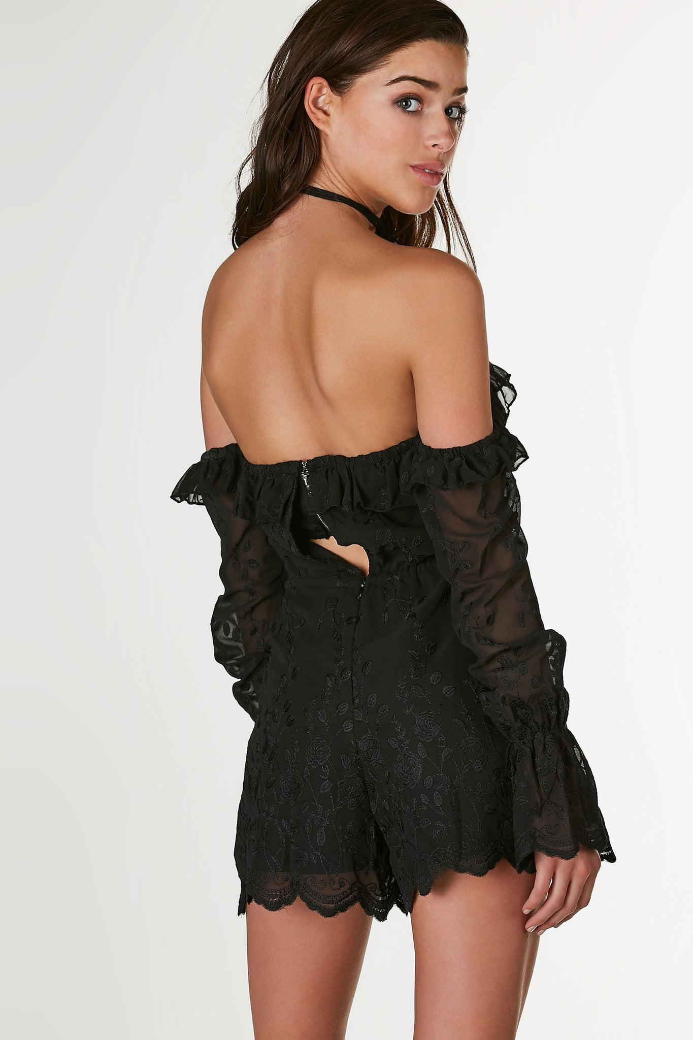 Flirty off shoulder romper with full lining and chiffon overlay. Ruffle trim detailing with floral embroidery throughout. Padded bust with drawstring at waist and back zip closure.