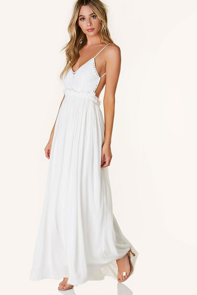 Gorgeous open back maxi dress with intricate crochet design and V-neckline. Fully lined with flowy fit.