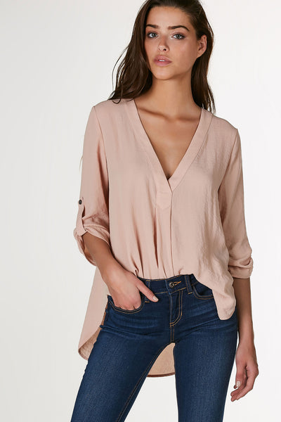 Breezy oversized blouse made of lightweight chiffon material. Classic V-neckline with 3/4 length sleeves and rounded hi-low hem.