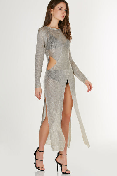Long sleeve loose knit metallic dress with chic overlap design and cut outs at waist.